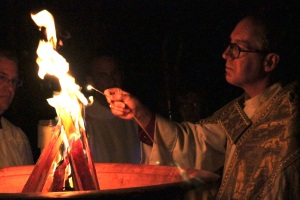 Bishop James Mathes of San Diego kindles the Easter fire at St. Paul's Cathedral.